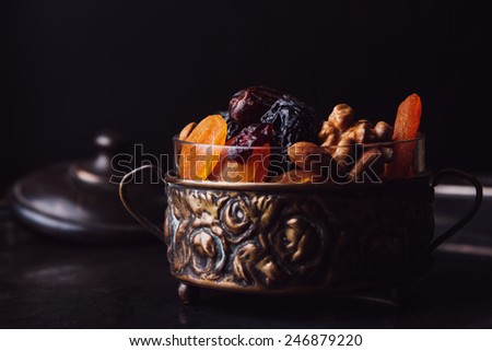 Dried fruit in a vintage dish - stock photo
