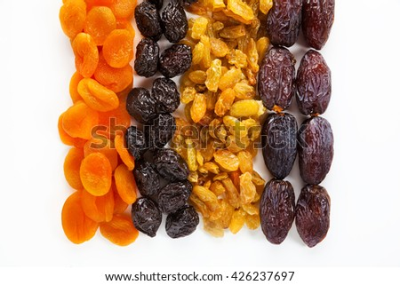 dried fruit isolated on white background. dates, raisins, dried apricots, prunes