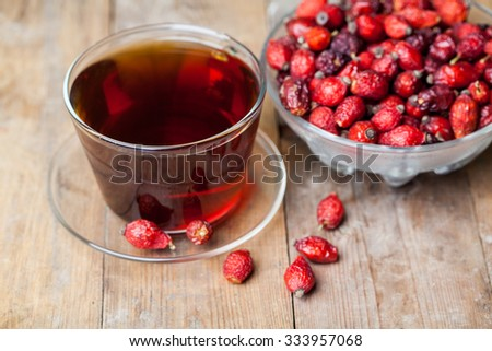 Dried fruit of hawthorn on the green rustic background - stock photo