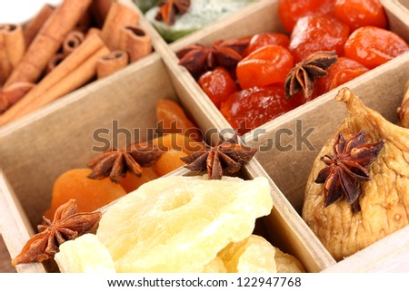 Dried fruits and cinnamon with anise stars in box close-up