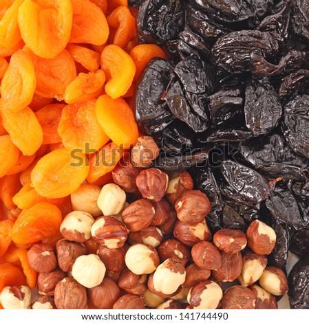 Dried fruits and hazelnuts backgtound Dried fruits and hazelnuts backgtound - stock photo