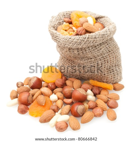 dried fruits and nuts in linen basket isolated on white background - stock photo
