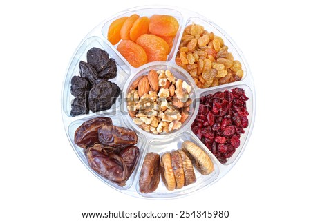 Dried fruits and nuts in plastic container for food storage. Raisin, cranberry, fig, plum, date, apricot fruits, walnuts and  almonds isolated on a white background - stock photo