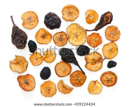 dried fruits, dried apples, pears, plums, white background, top view - stock photo