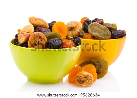 Dried fruits in bright bowls isolated on white - stock photo
