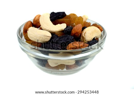 Dried fruits in glass bowl - stock photo