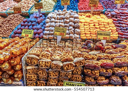 Dried fruits like apricot, fig, anise, kiwi, apple, dates etc. on showcase in containers for sale at grand bazaar, Istanbul, Turkey.