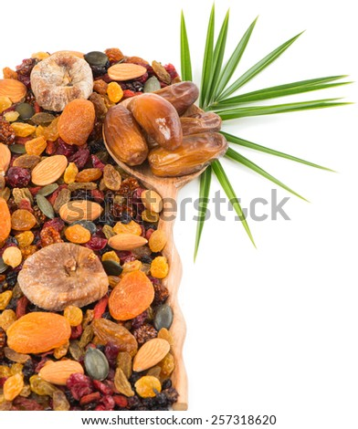 Dried fruits, nuts, seeds and berries assortment isolated on white background, top view - stock photo