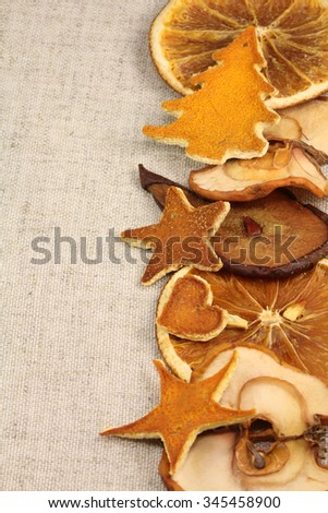 Dried fruits on Christmas background of gray natural fabric