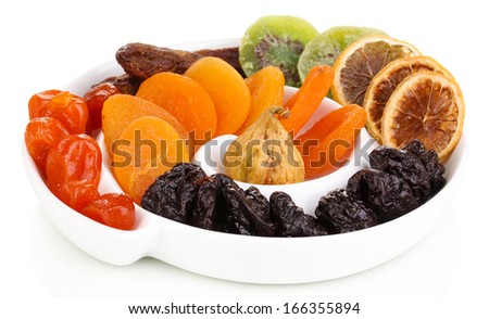 Dried fruits on plate isolated on white - stock photo
