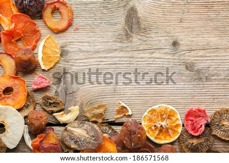 Dried fruits on vintage wooden boards still life - stock photo
