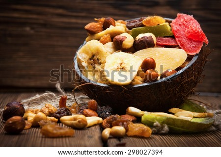 Dried fruits on wooden background - stock photo