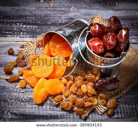 Dried fruits raisins, apricot, dates. Selective focus, toned