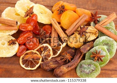 Dried fruits with cinnamon and anise stars close-up - stock photo