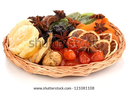 Dried fruits with cinnamon and anise stars isolated on white - stock photo