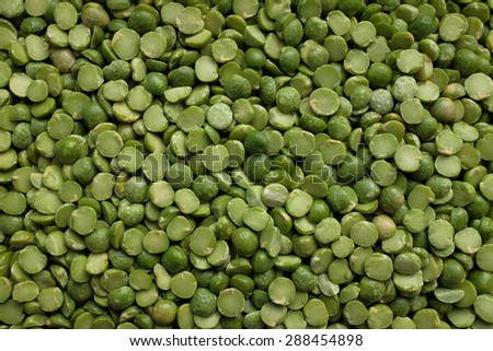Dried green split peas as an abstract background texture - stock photo