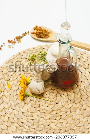 dried herbal flowers and massage pouches