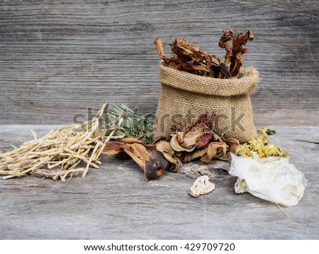 Dried herbal medicine chinese on rustic wooden background with copy space - stock photo