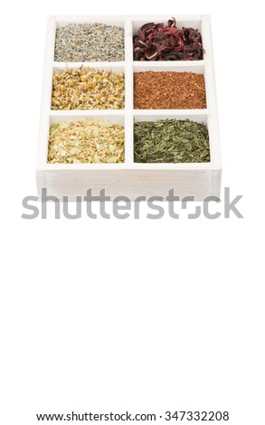 Dried herbal tea leaves, lavender, rooibos, chamomile, linden flower, hibiscus, Japanese green tea in white wooden box over white background