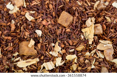 Dried herbal tea with fruit pieces, food background
