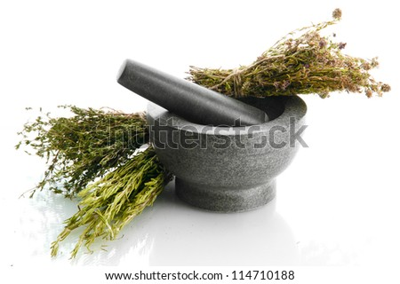 dried herbs in mortar, isolatrd on white - stock photo