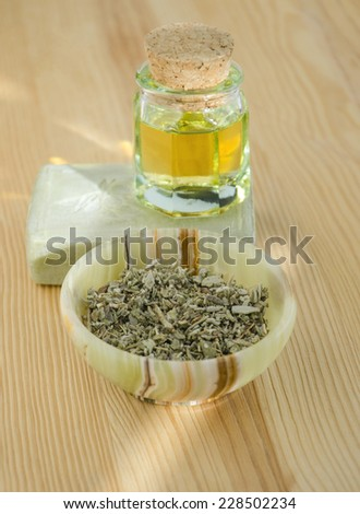Dried herbs, oil and organic soap for skincare and haircare - stock photo