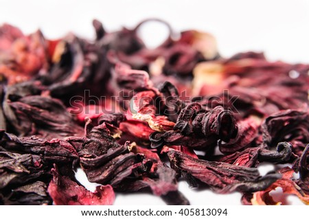 Dried hibiscus calyces on a white background - stock photo
