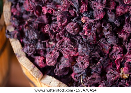 dried hibiscus flowers in a wooden bucket - stock photo