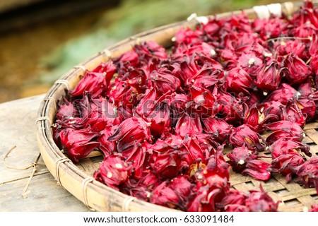 Dried hibiscus flowers in basket weave