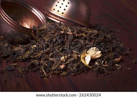 Dried japanese green tea infused with jasmine flowers - stock photo