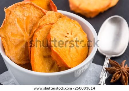 Dried Kaki fruit Dried Persimmon slice, on black background - stock photo
