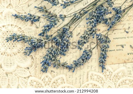 dried lavender flowers and vintage love post cards. nostalgic still life. retro style toned picture - stock photo