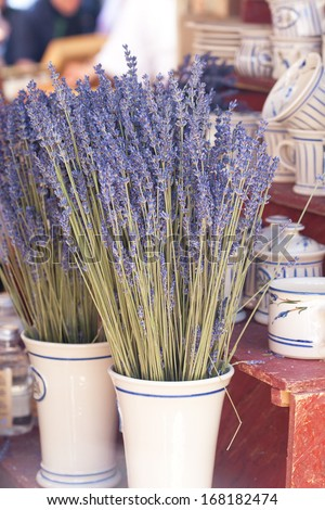 dried lavender flowers in a vase at the fair - stock photo