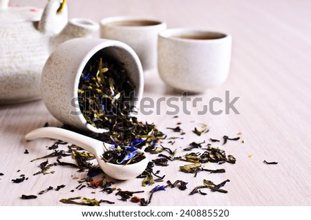 Dried leaves of black and green tea with blue cornflower petals. - stock photo