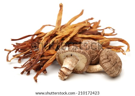 Dried Lily Buds and shiitake on white background
