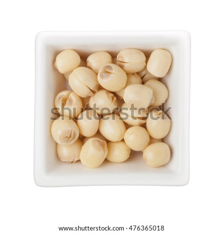 Dried lotus seeds in a square bowl isolated on white background