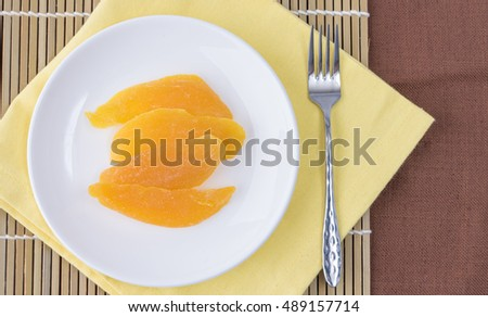 Dried mango in white dish ready to eat (Top view)