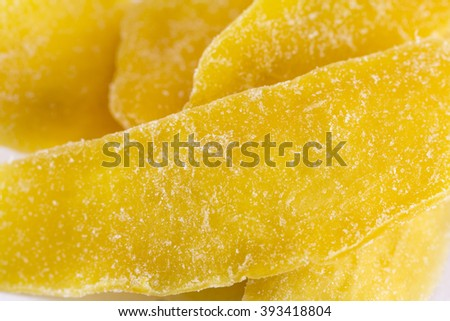 Dried mango slices on a white background