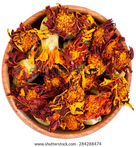 Dried Marigold flowers in a small wooden bow isolated on white. - stock photo