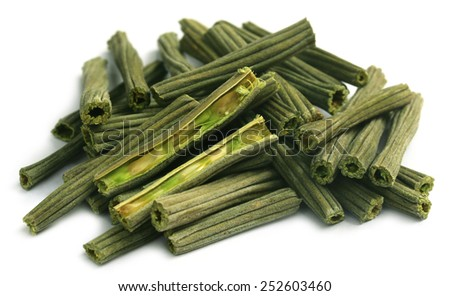 Dried moringa oleifera over white background - stock photo