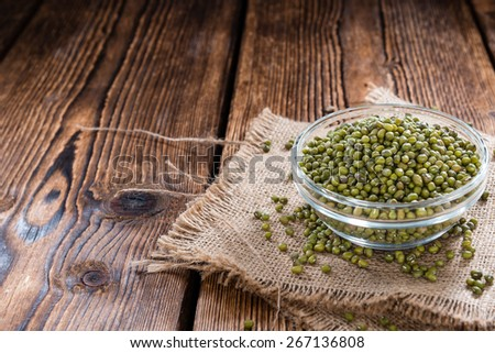 Dried Mung Beans (detailed close-up shot) on vintage wooden background - stock photo