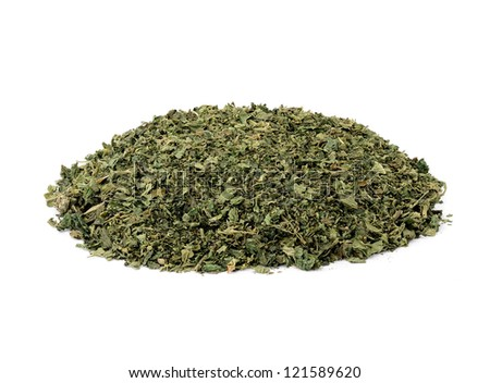 dried nettle tea on white background