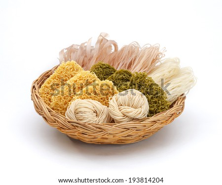 Dried noodles in the basket isolated on white background - stock photo