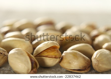 dried nut , pistachio, rind is opened , see seed inside, high vitamin E,