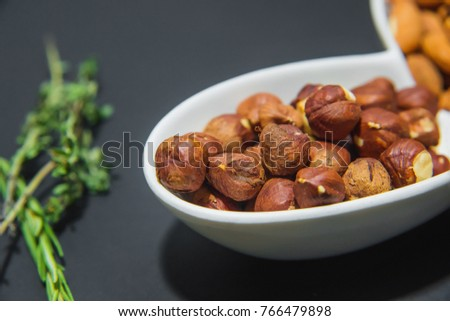 dried nuts for beer on a black background