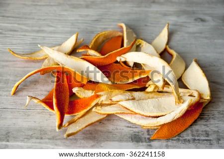 dried orange peel on the retro background - stock photo