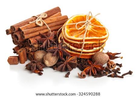 Dried orange, stars anise and cinnamon sticks  isolated on white background. - stock photo