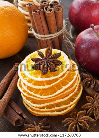 Dried oranges, anise, cinnamon and fruits. Shallow dof. - stock photo