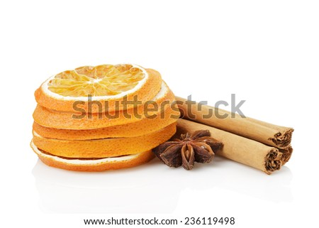 dried oranges with cinnamon and anise, isolated on white background - stock photo