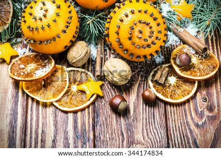 dried oranges with nuts and fir branches. Christmas decorations - stock photo